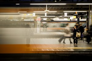 A woman watches the train arrive at Shinkjuku station, Tokyo